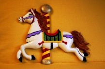 Clay Magic carousel wwll plaque bright