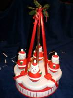 Kimple 1327 Roly Poly Santa Spinning Carousel