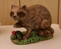 small raccoon figure (CC)