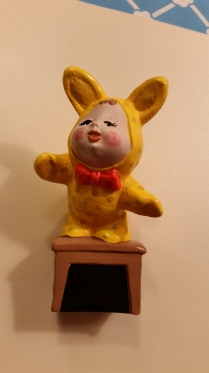 kid in bunny outfit on stool