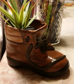 boot planter with plant
