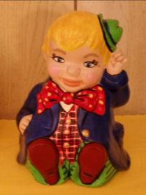 sitting boy clown bank