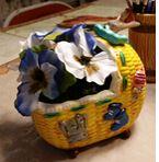 Duncan 0036c wicker cradle planter with flowers