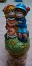 GIRL AND BOY HUGGING (Hummel Style) jar lid