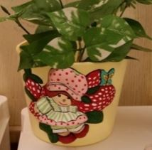 strawberry shortcake planter stained