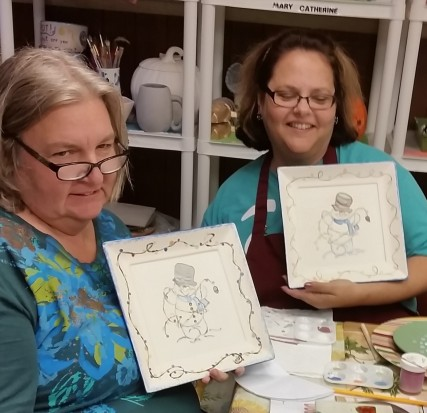 Sheryl & Laura with snowman plates from Lynnes WS
