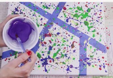 paint spattering canvas